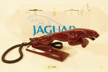 Telephone - Forrestal Telecommunications touch tone of leaping Jaguar, maroon