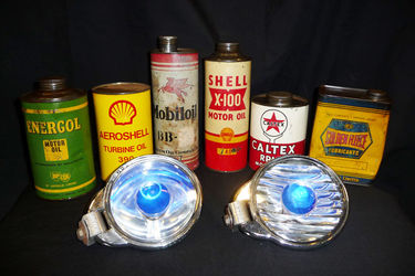 2 Notek driving lights (working) from early 1950s and a collection of oil tins