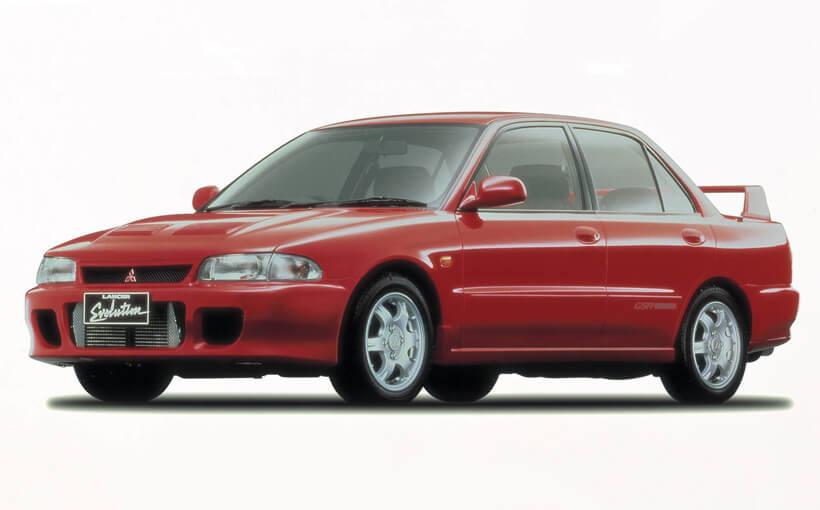 Mitsubishi Lancer Evolution: forest racer with a rego label