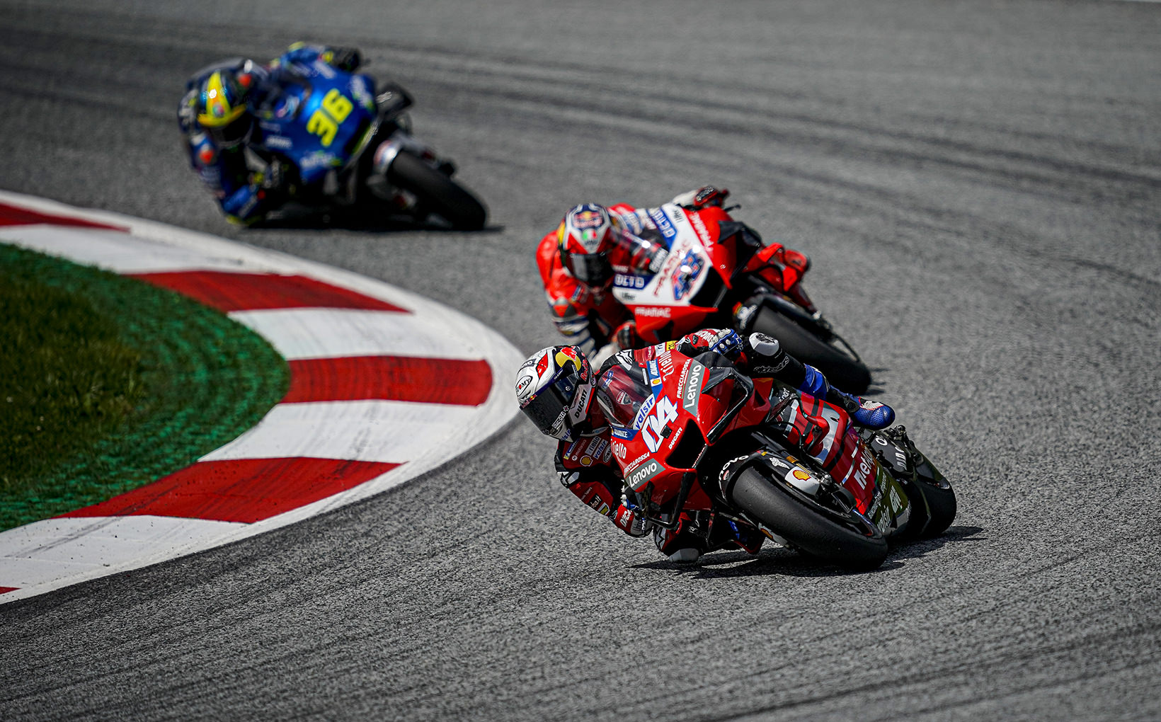 Andrea Dovizioso quits Ducati yet wins in Austria as Valentino Rossi & Maverick Vinales came within inches of being hit by Two MotoGP Machines.