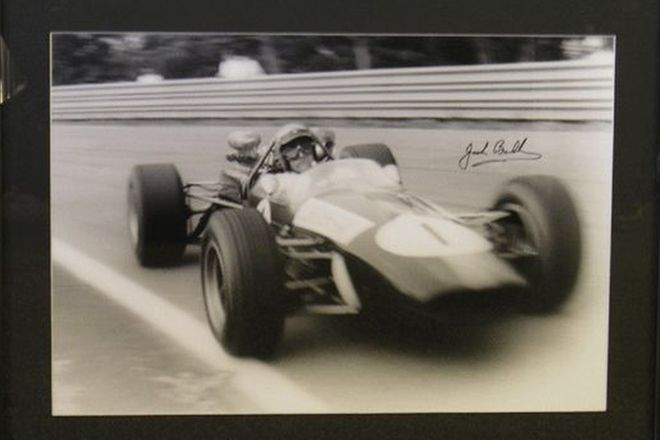 Framed Signed Photo- Sir Jack Brabham driving Repco Brabham at Warwick Farm