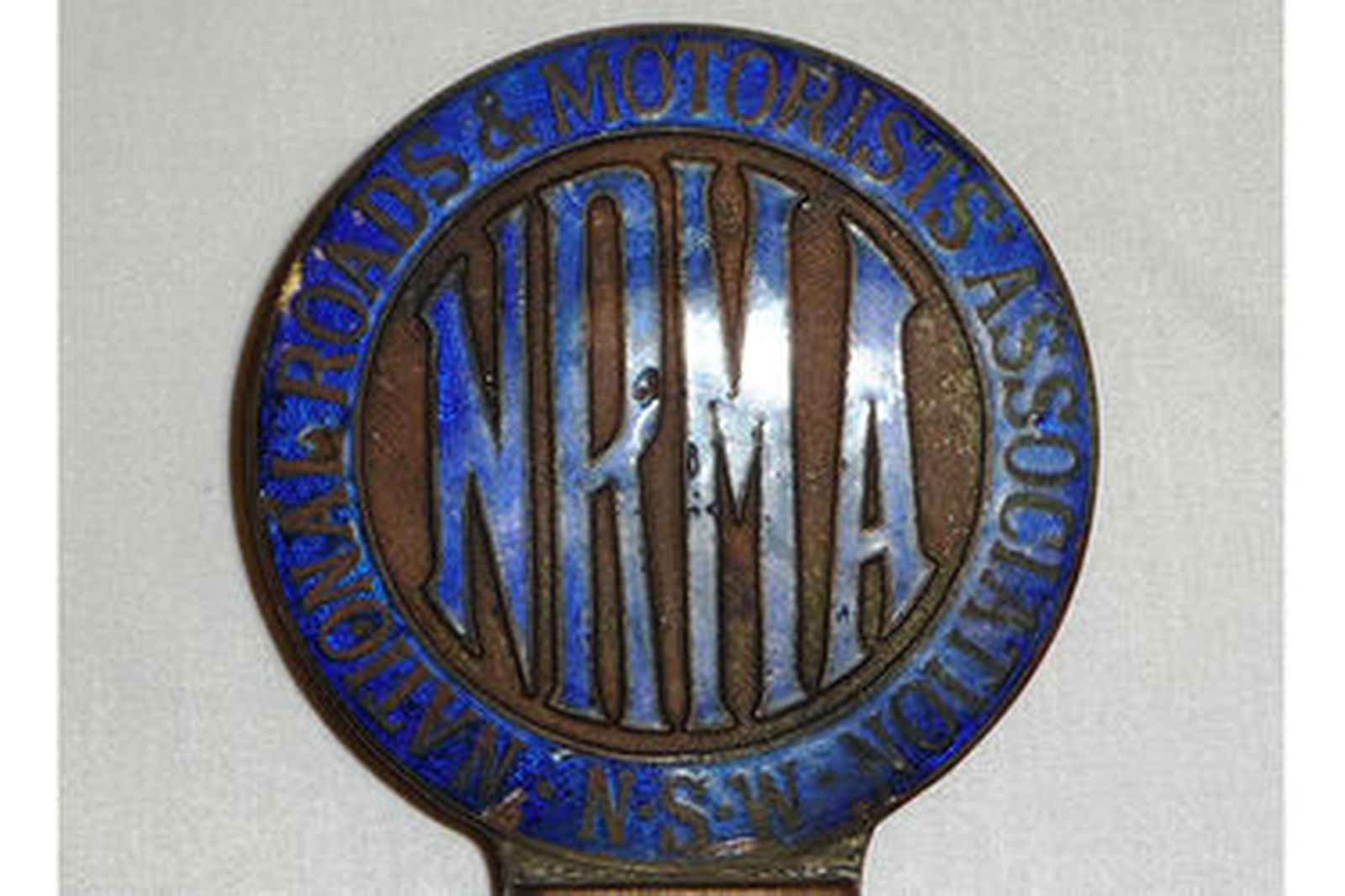 Cast Steel Michelin Man from large compressor (35cm tall) & early NRMA Badge