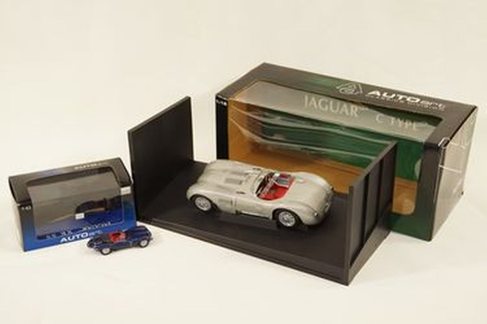 Model Cars x 2  - Autoart Jaguar C-Type Silver (1:18 scale) & XKSS Blue (1:43 scale) with boxes