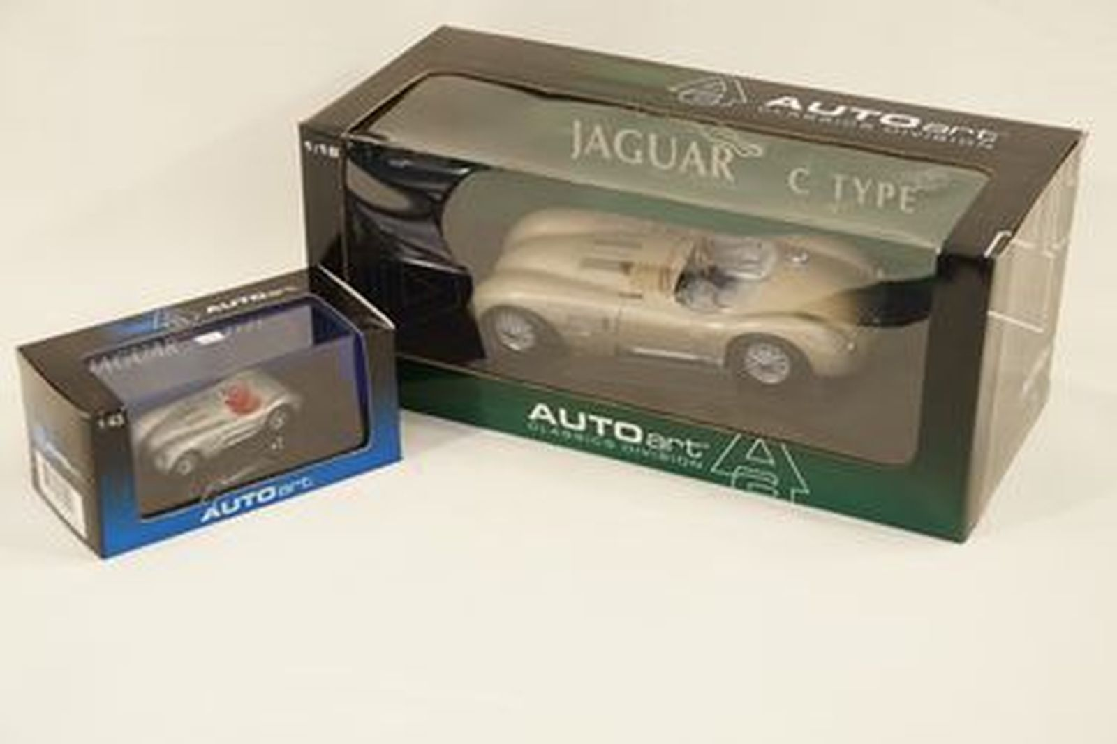 Model Cars x 2 - Autoart Jaguar C-Type Bronze (1:18 scale) & C-Type Silver (1:43 scale) with boxes