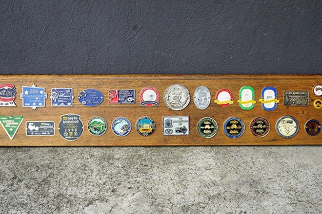 Badge Board - 30 x Assorted Australian Car Rally Badges mounted on board (152cm x 28cm)
