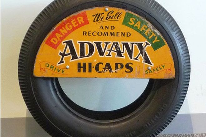 Sign - Advanx Tyre Sign (Timber) mounted on a Tyre