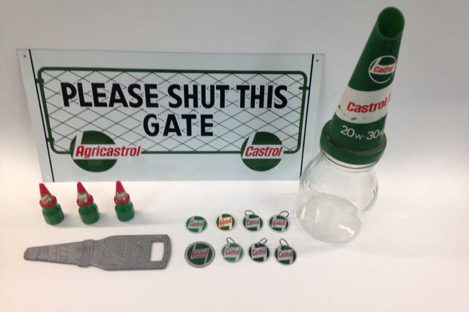 Assorted Castrol collectables - One sign, Oil bottle, key rings, pencil sharpner and bottle opener