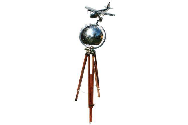 Polished Aluminium 'Flying Boat' on world globe mounted on teak tripod