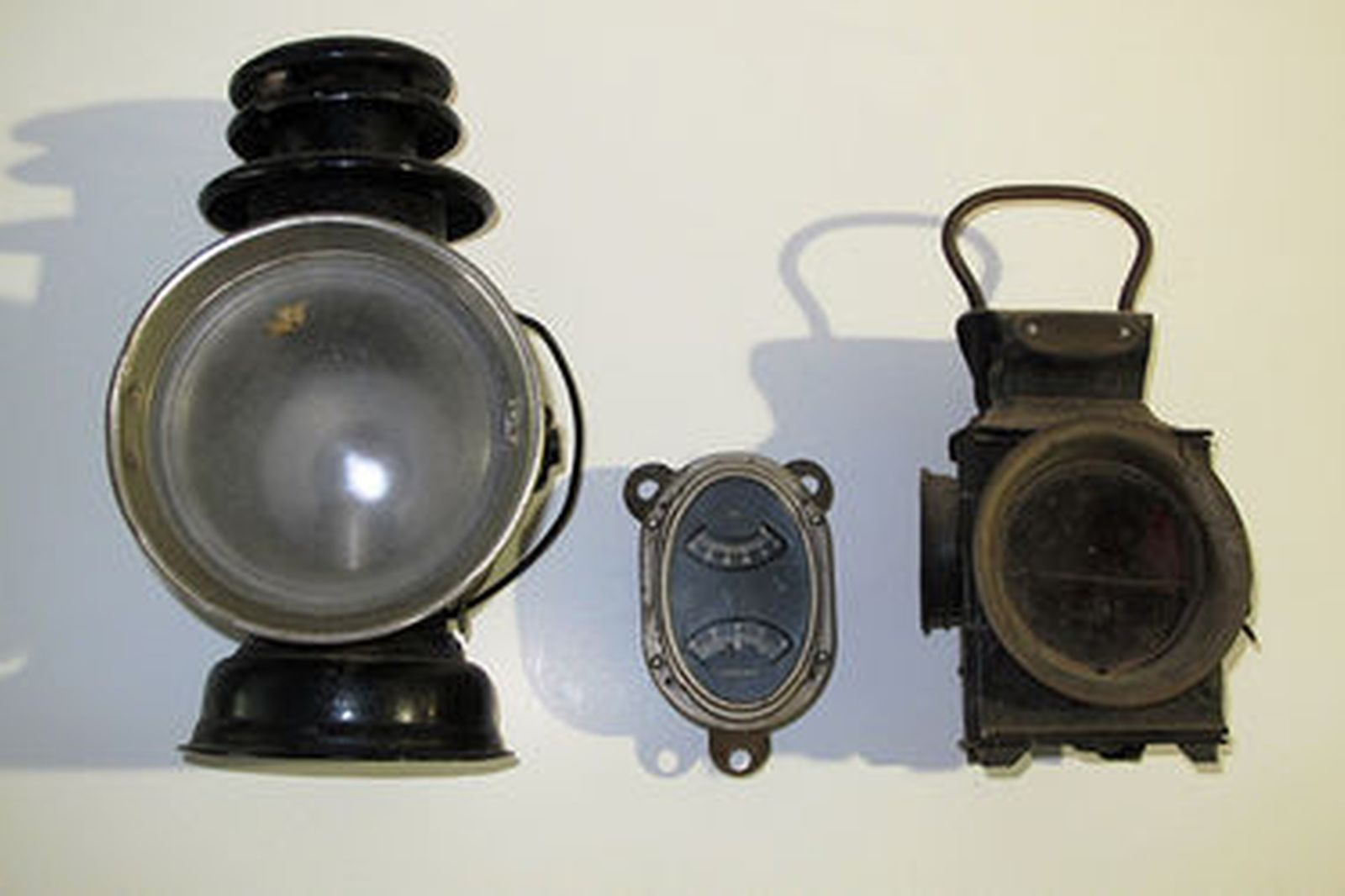 Collection - Early bonnet mascots, Motoring lamps, Packard Amp/Oil gauge (23 pieces total)