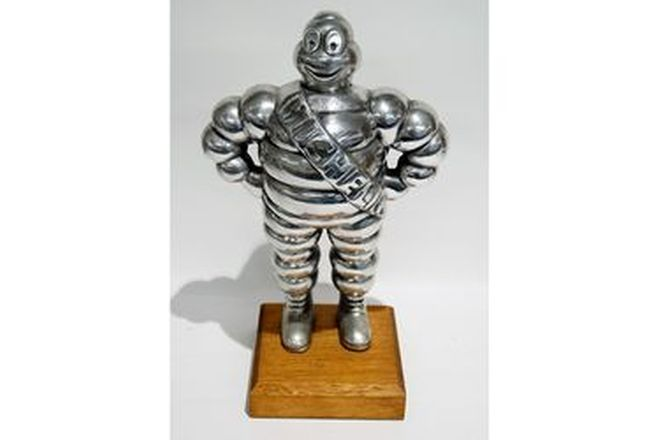 Figure - Michelin Man in Pewter on wooden base (33cm tall)
