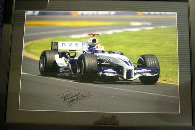 Framed Photo - Signed and framed photo of Mark Webber in 2005 FW 27 Car