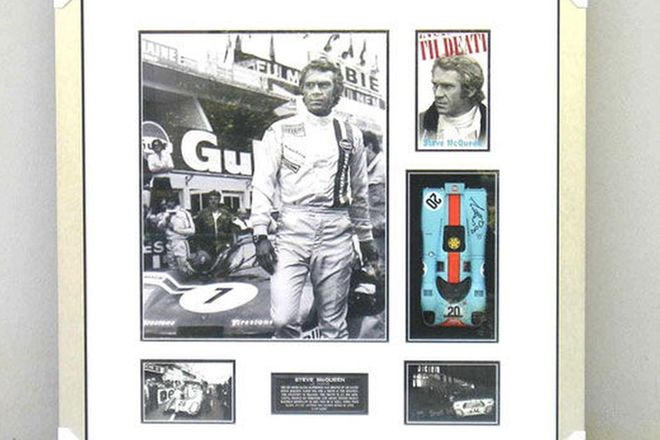 Framed Print of Steve McQueen with model Porsche 917 - signed by Brian Redman (1m x 82cm)