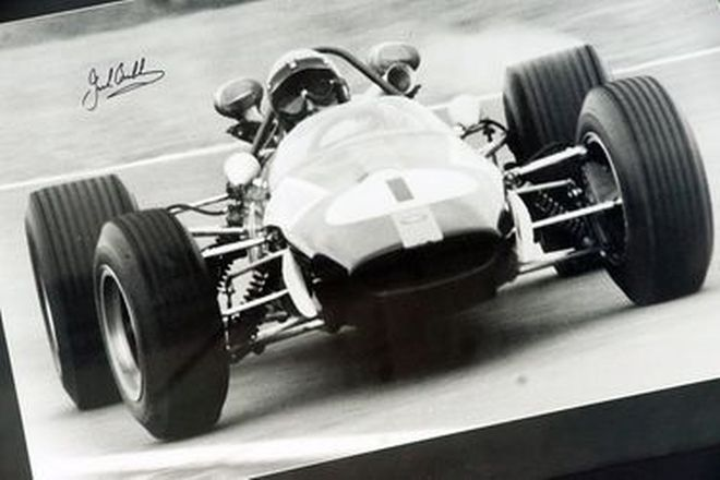 Signed Photo - Sir Jack Brabham Hand Signed Photo (Size - 78.5 x 58cm)