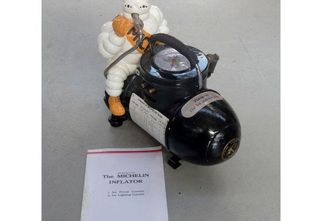 Compressor - c1930's Michelin Man (cosmetically restored) with copy of sales leaflet