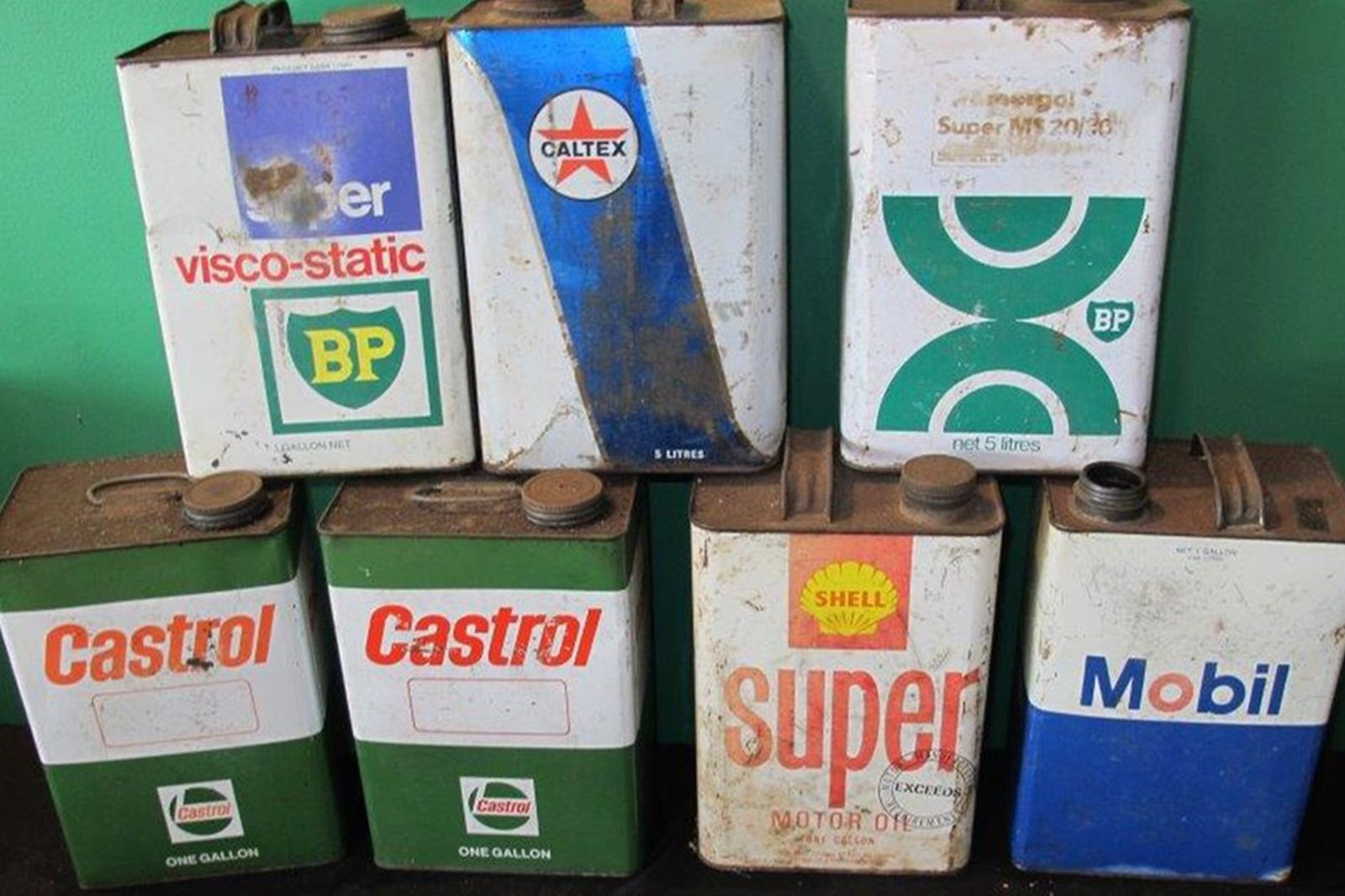 Assorted Fuel Cans x 8, Oil Bottle Basket and Tyre Pump