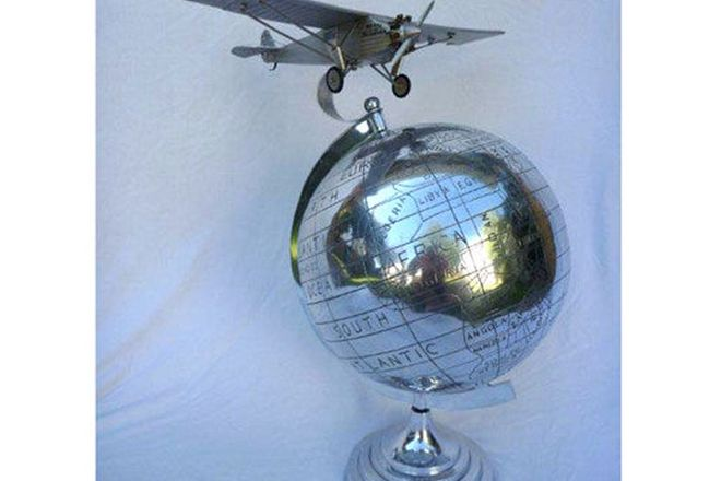 Polished Aluminium Globe of the World, with Spirit of St Louis plane mounted on top