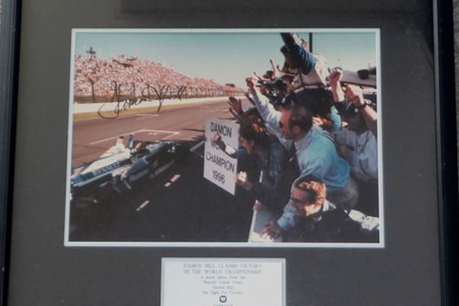 Framed Signed Print - Damon Hill Claims Victory in 1996 World Championship Signed by Damon Hill