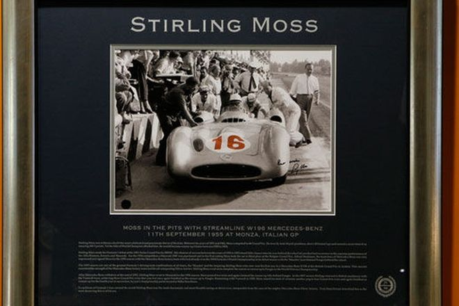 Framed signed print - Stirling Moss in Mercedes-Benz W196 at 1955 Monza GP