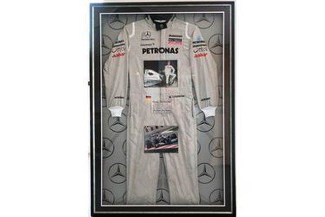 Framed Replica Racing Suit - Michael Schumacher's signed Mercedes-AMG Petronas Racing Suit