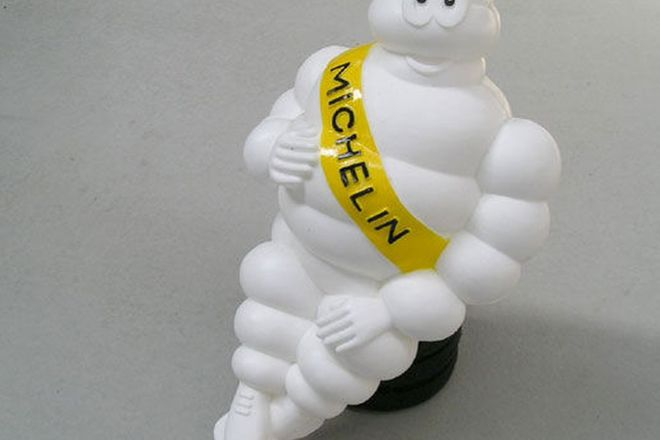 Light - Michelin Man sitting on Tyres